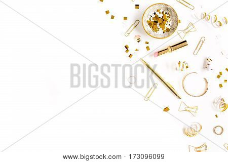 Beauty blog background. Gold style feminine accessories. Golden tinsel scissors pen rings necklace bracelet on white background. Flat lay top view.