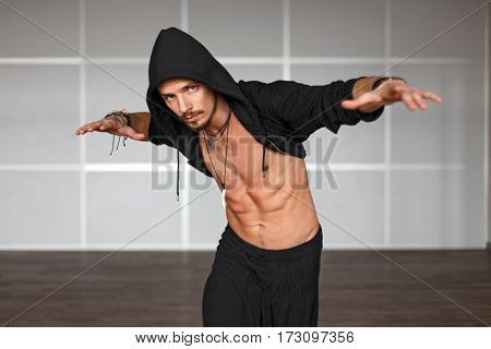 Fashionable Handsome Male Dancer Dancing On The Dance Floor