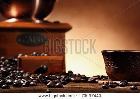 coffee beans . vintage coffe mill defocused.Closeup .Selective focus