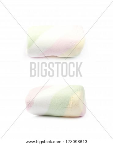 Single piece of marshmallow candy isolated over the white background, set of two different foreshortenings