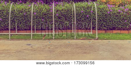 vintage tone image of bicycle parking area in garden for background usage.