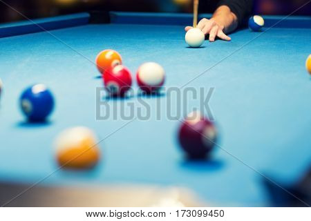 pool billiard hand aiming the cue ball
