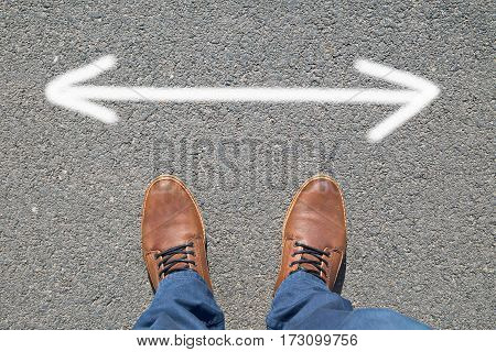 Feet on the street with text ARROWS
