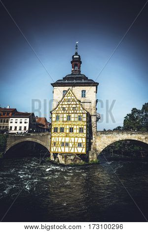 River Regnitz flowing past the Rathaus, or Old Town Hall, Bamberg, Germany which is built on an island in the center of the river in this UNESCO World Heritage Site
