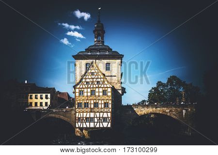 The historic Rathuis or Town Hall in Bamberg, Germany, built on an island in the centre of the River Regnitz and a popular tourist attraction