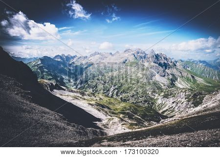 Beautiful from above on mountain valley with vignette sky near Oberstdorf, Germany. The famous Heilbronn via ferrata runs on the line.