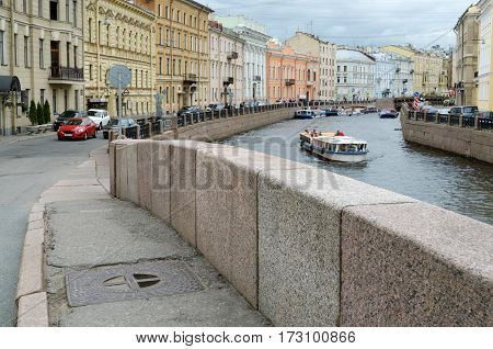 The beautiful landscape of the city with the granite embankment .