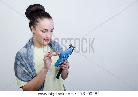 a girl dials up on a telephone