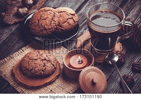 Homemade chocolate cookies on wooden black table background. Food baking.