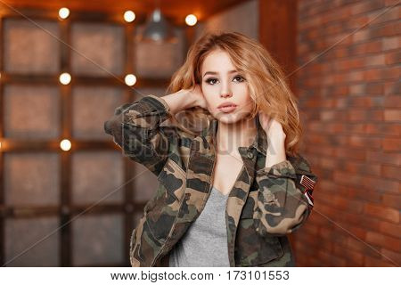Stylish Beautiful Young Woman In A Fashionable Jacket Near Wall With Lights