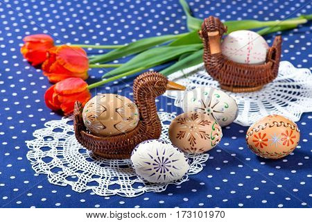 Easter Eggs And Tulips On The Blue Tablecloth