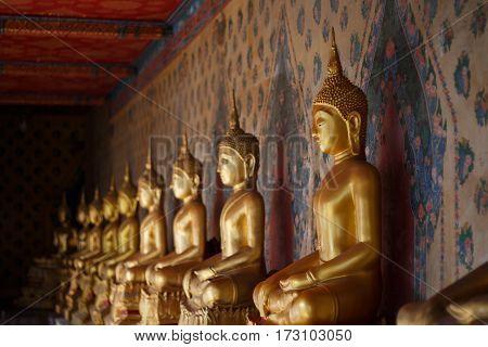 Golden buddha statue on temple Bangkok, Thailand.