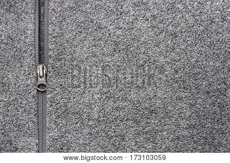 Grey Fleece Fabric With Zipper Background Texture Copyspace.