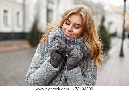 Beautiful Stylish Woman In Winter Clothes On City Background