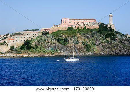 Sailboat Cruising In Front Of Portoferraio On Elba Island