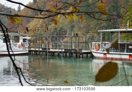 PLITVICE, CROATIA - OCTOBER 16, 2016: Boats on the river in Plitvice national park
