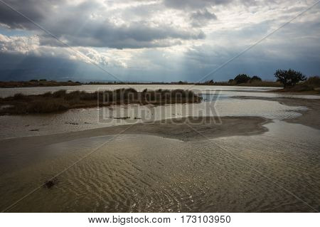 Landscape with water and stormy clouds at Punta, Peloponnese, Greece