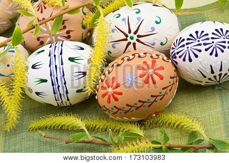 Four Easter Eggs On The Green Tablecloth