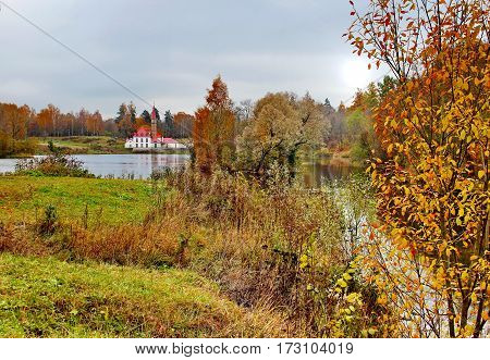 Beautiful romantic alley in a park with colorful trees and sunlight. autumn natural background Gatchina Beautiful romantic alley in a park with colorful trees and sunlight. autumn natural background Gatchina