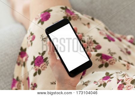 woman in dress floral print holding phone with isolated screen