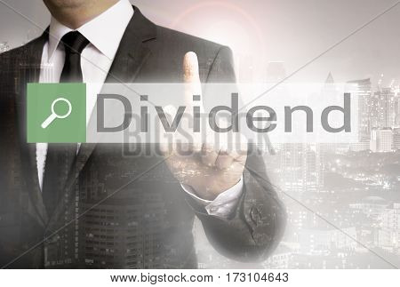 Dividend Browser With Businessman And City Concept