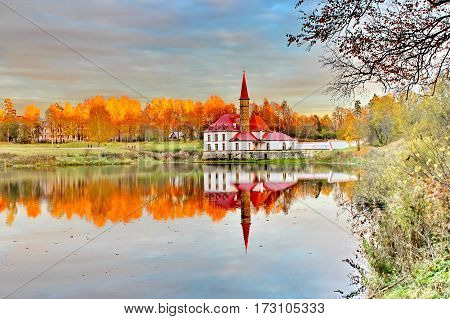 Beautiful romantic alley in a park with colorful trees and sunlight. autumn natural background Gatchina