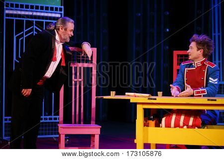 MOSCOW - OCT 19, 2016: Two actors talk on stage during Premium class Performance in Modern theater