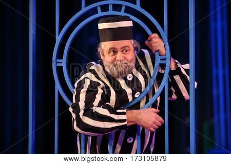 MOSCOW - OCT 19, 2016: Prisoner behind lattice during Premium class Performance in Modern theater