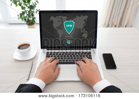 man holding notebook with app vpn creation Internet protocols for protection private network