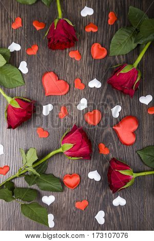 Red Roses And Hearts  On A Wooden Background.