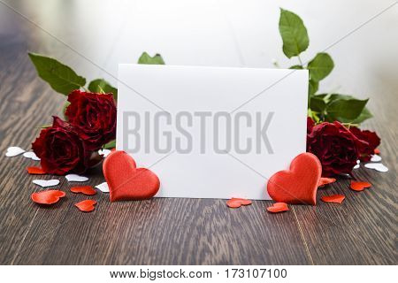 Red Roses, Hearts And Card On A Dark Wooden Background.