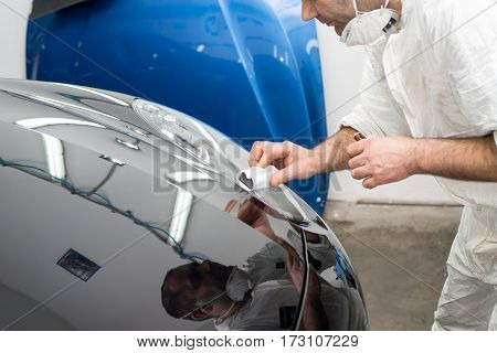 Man on a car wash polishing car with a polish machine