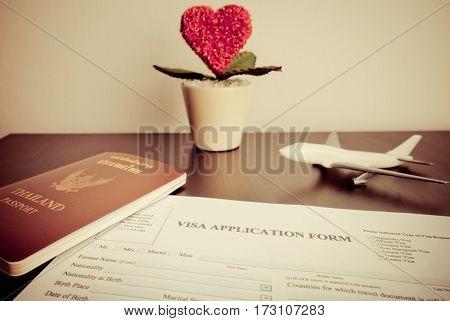 Documents for Visa for Homneymoon trip on desk