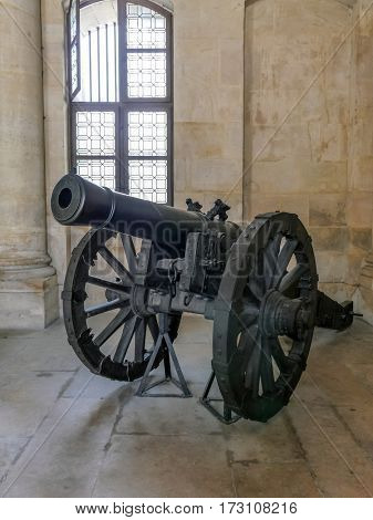 PARIS, FRANCE - 25 AUGUST, 2013: Historic artillery gun at the National Residence of Invalids, Paris, France