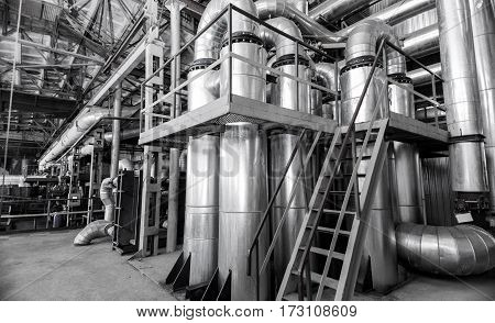 Industrial premises with large sugar refinery pipes