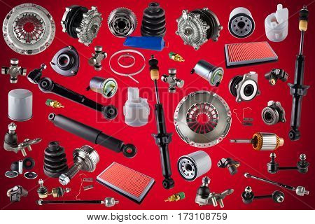 Spare auto parts car on the red background. Set with many isolated items for shop or aftermarket