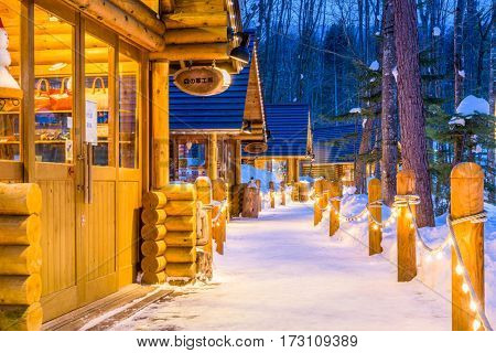 FURANO, JAPAN - FEBRUARY 15, 2017: Ningle Terrace at twilight. The collection of cottages situated in the woods are boutique shops specializing in handmade craft items.