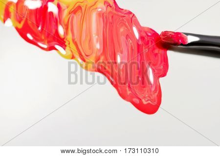Colorful nail lacquer ads nail polish splatter on white background