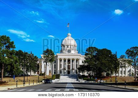 Montgomery Alabama USA - January 28 2017: Alabama State Capitol building as viewed from Dexter Avenue against a blue sky.
