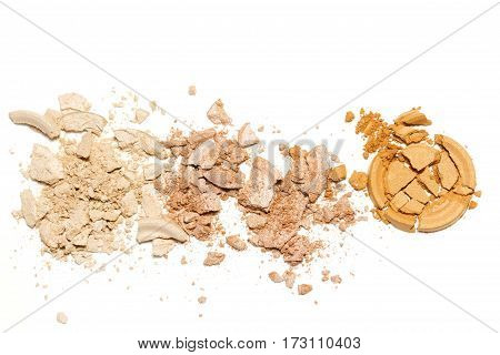 Gold beige eye shadow crushed cosmetic isolated on white background.Beauty fassion and style.