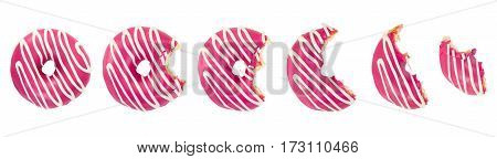 Eaten donut with pink icing and white stripes isolated on white background. Top view.