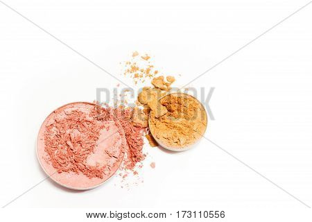 Pink and gold eyeshadow isolated on white background