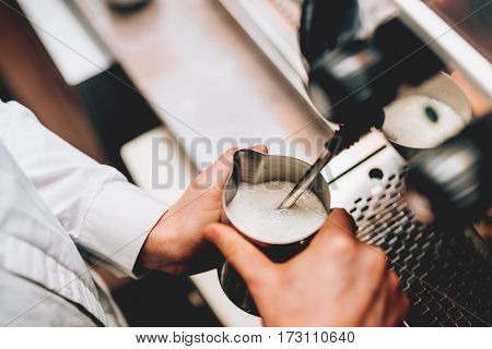 Professional Bartender Warming Milk For Cappuccino. Barista Using Coffee Machine For Latte Art Macch