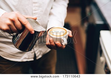 Barista Pouring Perfect Cappuccino Into Cup, Making A Delicious Morning Drink