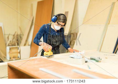 Female Carpenter In A Wood Shop