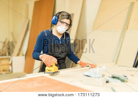 Woman Working In A Wood Shop