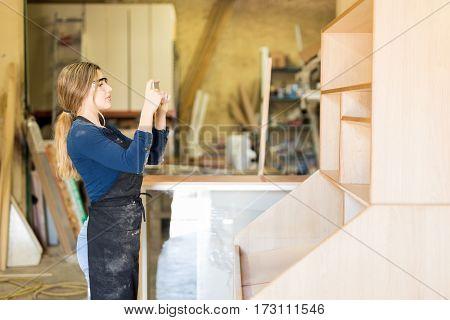 Female Carpenter Proud Of Her Work