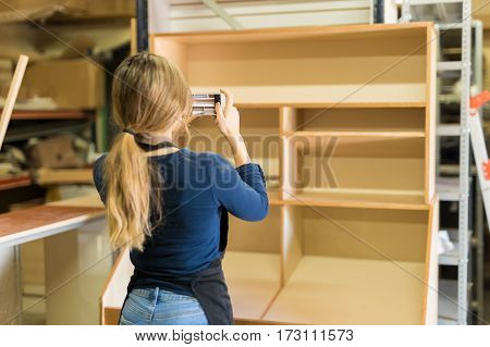 Woman Taking Photos Of Some Furniture