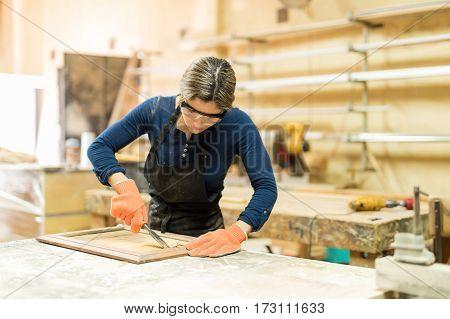 Female Carpenter Working In Her Woodshop
