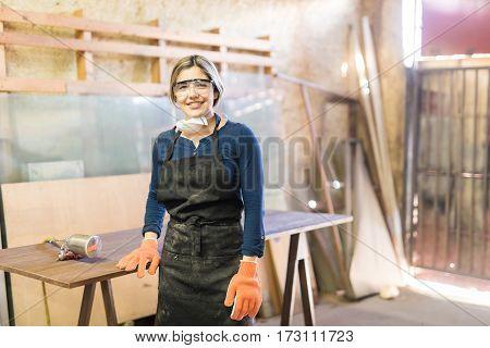 Beautiful Female Carpenter In A Woodshop